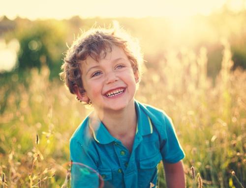 Joyful boy in field